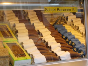 Schoki Bananen (Milk or white chocolate coated bananas) with sesame base